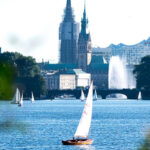 Sailboats on the Alster Lake on a summer evening
